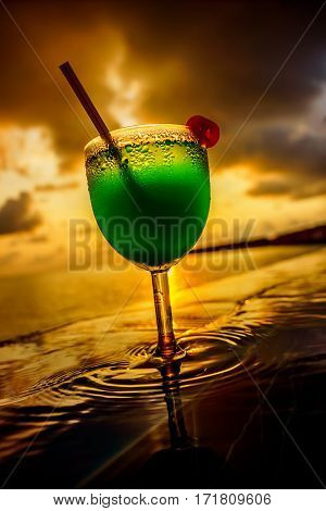 Cocktail near the swimming pool at sunset