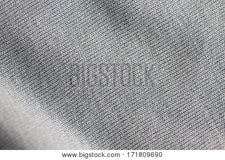 textile and texture concept - close up of gray cotton fabric background