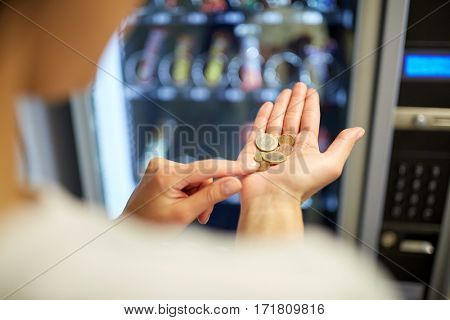 sell, technology, people, finances and consumption concept - woman counting euro coins at vending machine