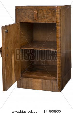 Cut out of a vintage wooden bedside nightstand cabinet with its door opened