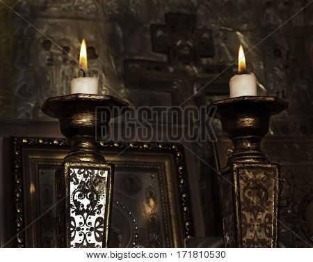 Lighting candles in a church, vintage style