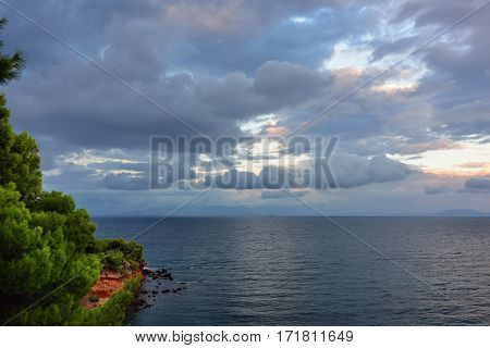 Beautiful view on the Aegean sea and dramatic cloudy sky at sunset Attica Greece