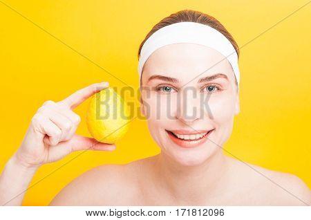 Portrait Of Sensitive Woman Holding Lemon Near Face