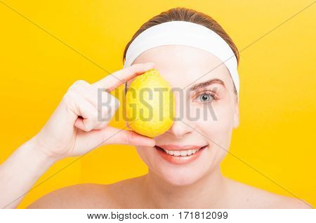 Pretty Female Covering Her Eye With A Lemon
