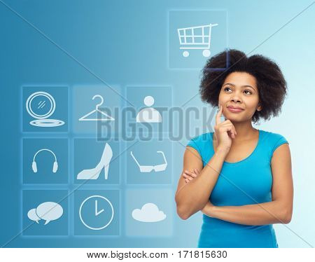 people, e-commerce and online shopping concept - happy afro american young woman over blue background with menu icons
