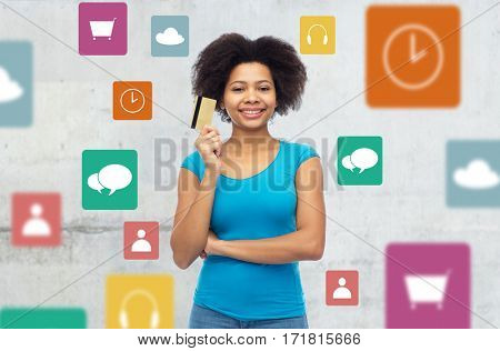 people, e-commerce and online shopping concept - happy afro american young woman with credit card over gray background with menu icons
