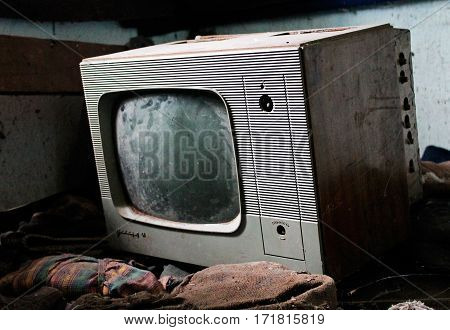 Old, borken  tv in an abandoned house