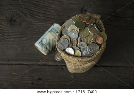 big money bag isolated on a concrete background.