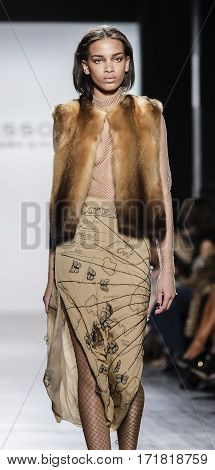 New York, NY, USA - February 14, 2017: A model walks runway for Dennis Basso FW17 collection runway show during New York Fashion Week at Skylight Clarkson Sq., Manhattan