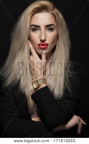 Beautiful young model woman with red lips and shine hair. Business woman in black suite.