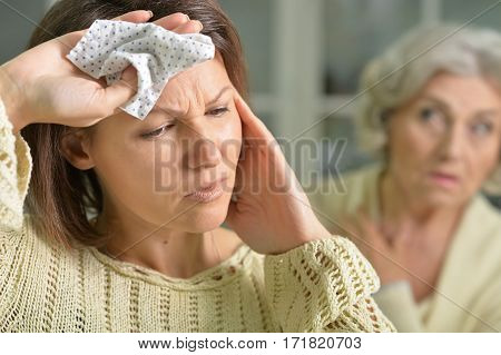 Portrait of a sick young woman holding handkerchief