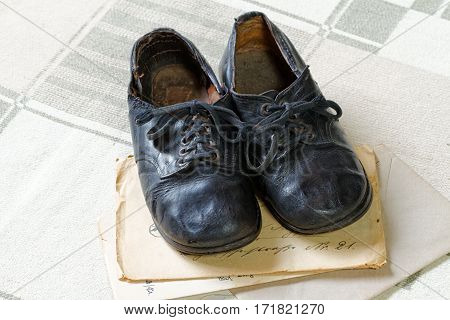 Remembrance of Childhood: Vintage Children's Shoes and Letters