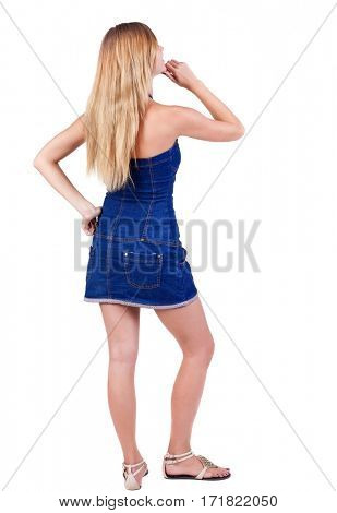 Back view of  thinking young beautiful woman. Rear view. isolated over white background. Concept of idea, ask question, think up, choose, decide.