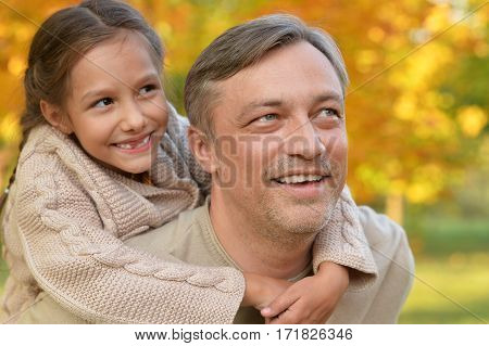 happy father and  daughter posing outdoor in autumn