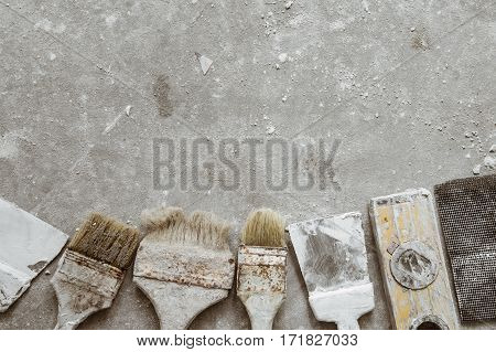 Plastering Tools On Cement Background.