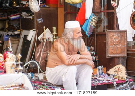 Mostar Bosnia Herzegovina - 2 September 2004: Man owner of a gift shops at Mostar
