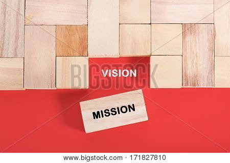 Wooden cube with a word VISION MISSION