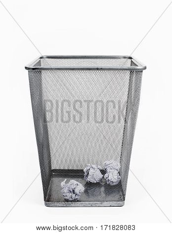 Crumpled paper in the bin on white background.
