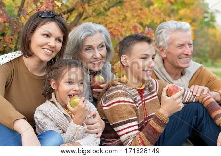 big family on picnic outdoors in autumn
