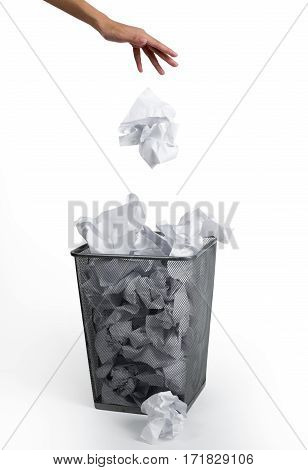 Woman hand putting paper in a bin on white background.