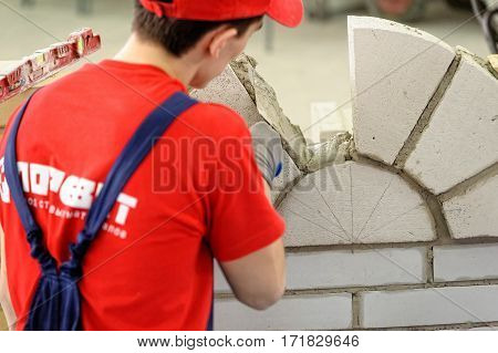 Tyumen Russia - February 16. 2017: Open championship of professional skill among youth World skills Russia Tyumen - 2017. Young bricklayer performs a task of competition of professionals