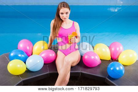 Woman With Balloons And Cocktail Drink At Swimming Pool.