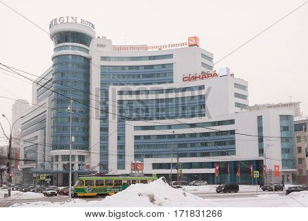 Yekaterinburg Russia - 01.22.2017: the Building which houses the Pipe Metallurgical Company and a Hotel Onegin in a cloudy winter day. The building is located at the intersection of the streets of Kuibyshev and Rosa Luxemburg.