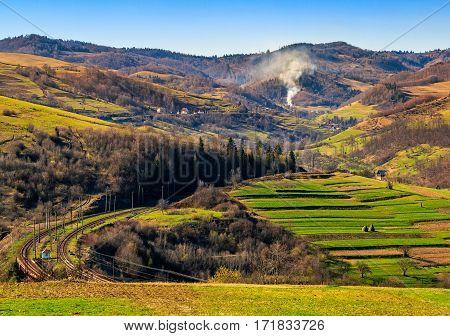Rail Road Winds Through Mountainous Rural Area