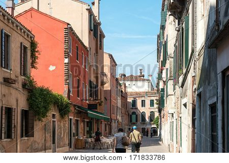 VENICE, ITALY - June 30, 2016.street view of old buildings in Venice. its entirety is listed as a World Heritage Site, along with its lagoon.June 30, 2016, VENICE, ITALY
