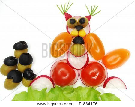 creative funny vegetable food snack with tomato squirrel with nuts form