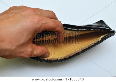 Man hand opens a empty wallet. No more money...