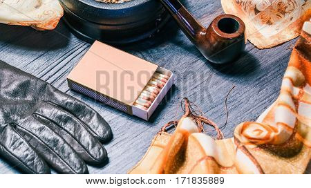 Set of fall womens accessories with smoking pipe and matches