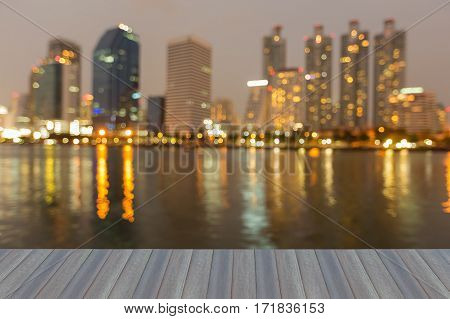 Opening wooden floor blurred bokeh lights office building with water reflection abstract background