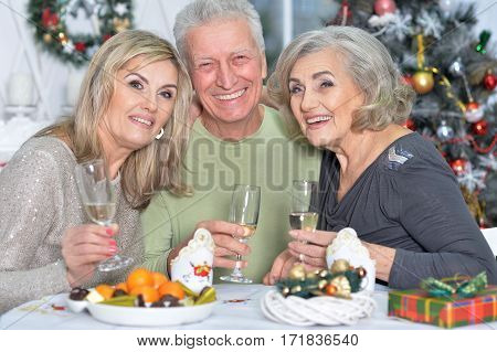 two mature women and man celebrating new year