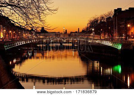 DUBLIN, IRELAND - DEC 28: Liffey Bridge known as Ha'penny Bridge is a pedestrian bridge over the river Liffey in Dublin City Centre on Dec 28, 2016 in Dublin, Ireland. Built in 1816 of cast iron