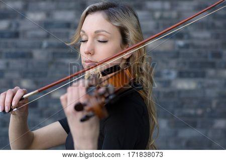 Woman Enjoying Playing Violin