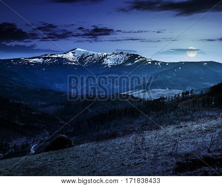 Agricultural Field With Haystack On Hillside At Night