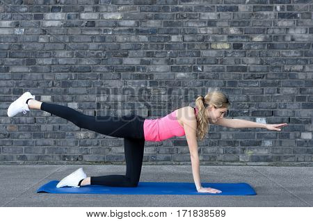 Fit Woman Strengthening Her Thigh Muscles