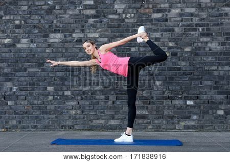 Woman Twisting Herself For A Stretch