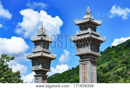Part Of Architectural Gate Buddhist Temple In Vietnam. Two Columns.