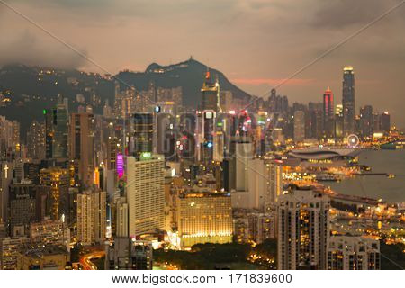 Blurred bokeh lights Hong Kong business downtown aerial view abstract background
