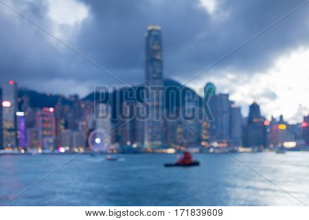 Blurred lights night view Hong Kong central business downtown sea front abstract background