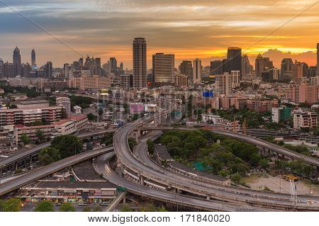 Bangkok city with highway intersection aerial view with dramatic after sunset sky background Thailand