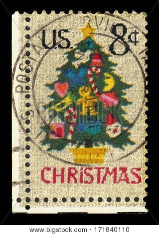USA - circa 1973: A stamp printed in United States of America shows Christmas tree in needlepoint, series christmas, circa 1973