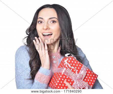 Portrait of a young woman holding present box