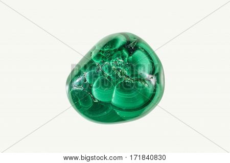 Rounded green malachite crystal stone isolated on white background