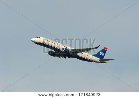 BOSTON - MAY. 6, 2015: US Airways Embraer 190 take off at Boston Logan International Airport, Boston, Massachusetts, USA.