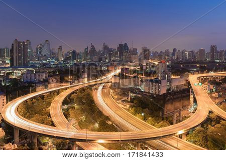 Aerial view Highway interchanged with city downtown background night view