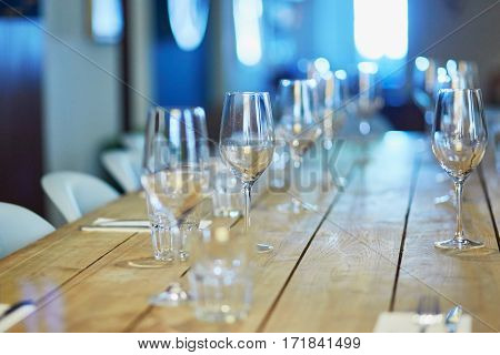 Wine Glasses On The Table In Restaurant, Bar Or Wedding Reception