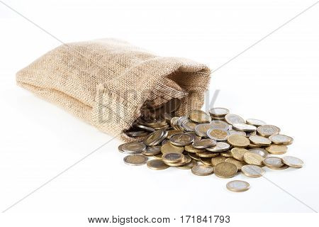 Coins Falling Out Of A Small Burlap Sack, On White Isolated Background.
